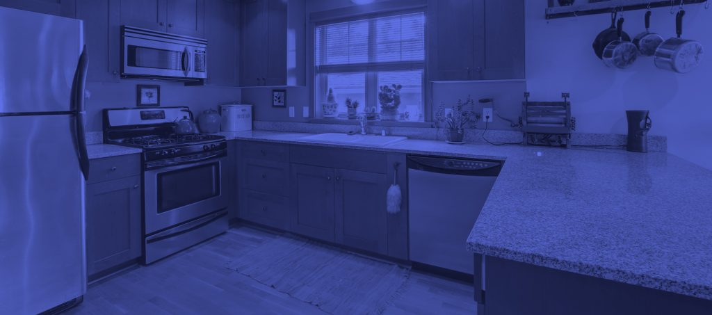 banner of granite counter tops with blue haze over it