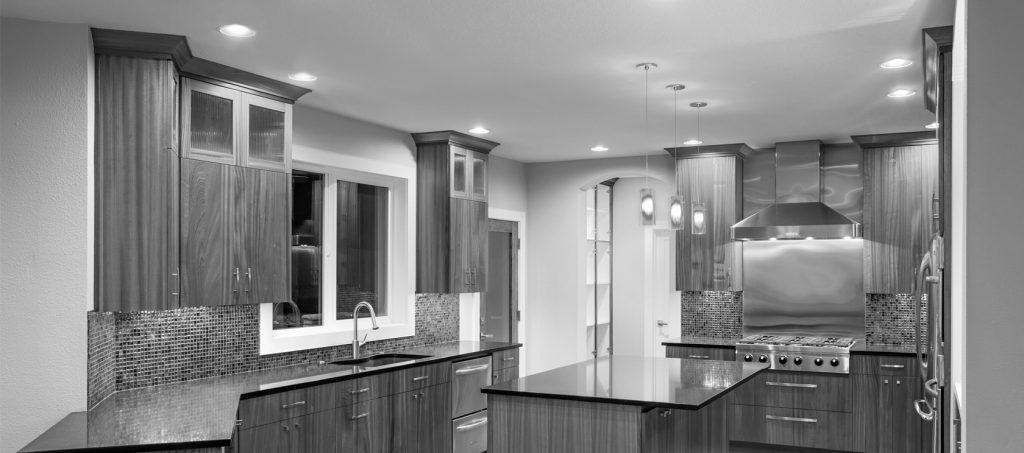 black and white slider of kitchen with granite countertop