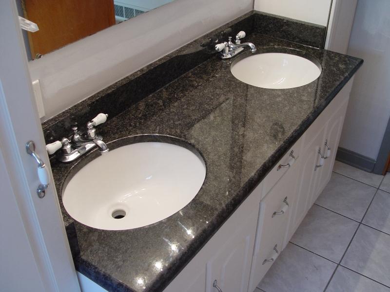 darker granite dual sink vanity in bathroom