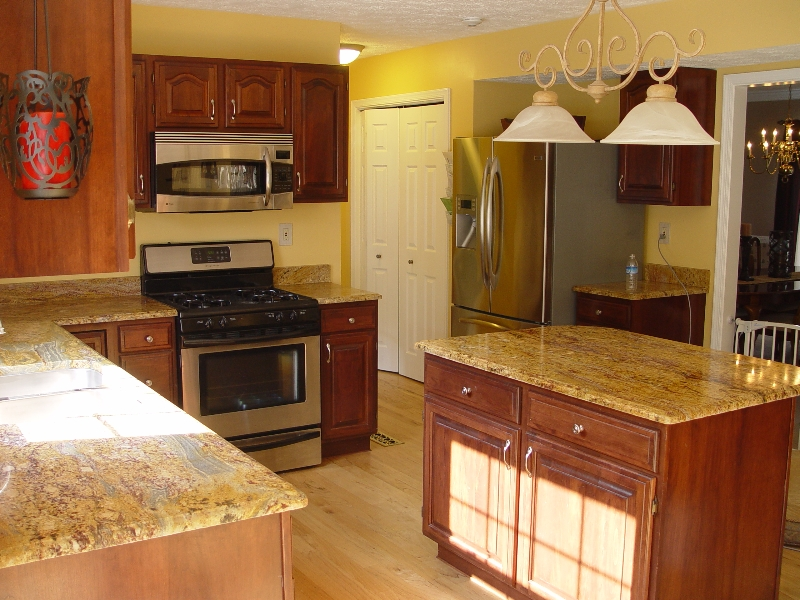 granite installed on the island and the cabinets in a Pittsburgh home