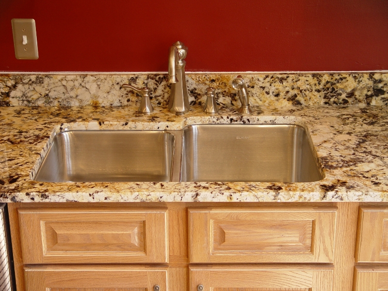 sink surrounded by new granite countertop