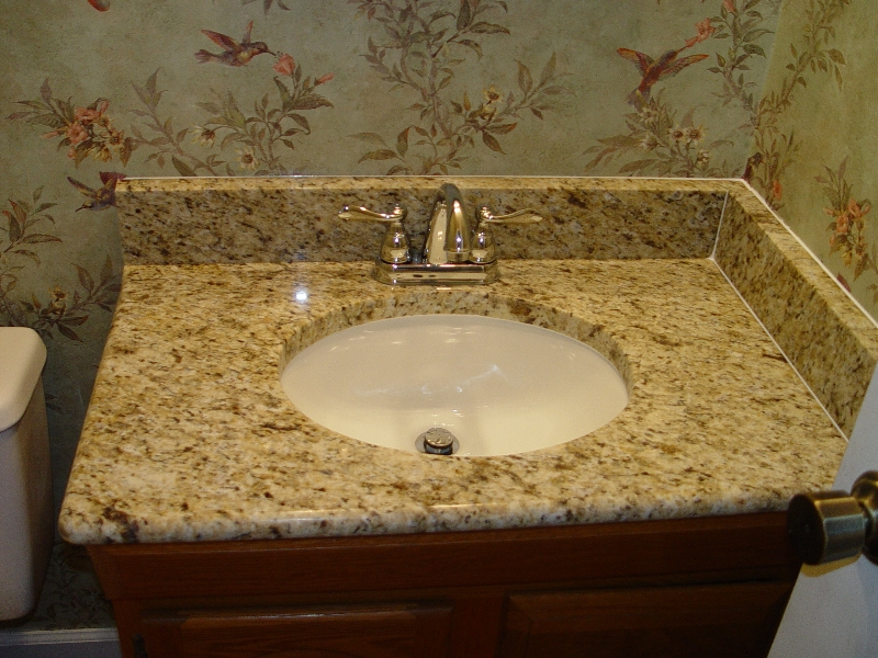 granite countertop in the bathroom with granite backsplash