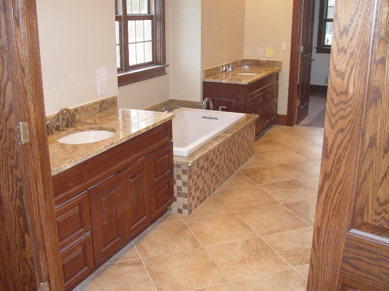 granite countertop in the bathroom on the sinks and tub