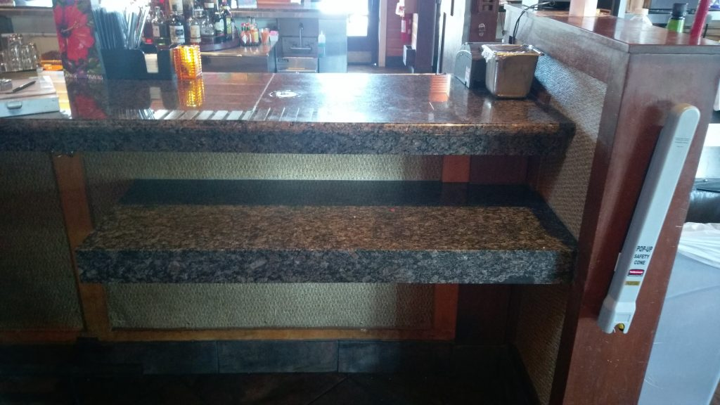 commercial granite countertop installation in a bar